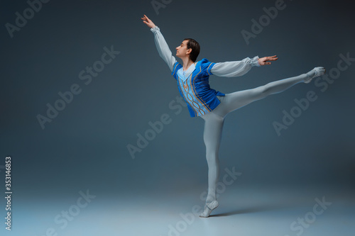 фотография Young and graceful ballet dancer as Cindrella's Prince on white studio background