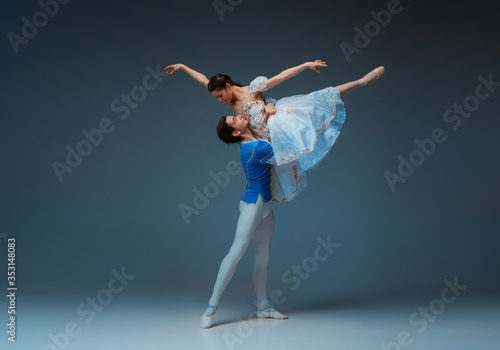 Young and graceful ballet dancers as Cindrella fairytail characters on studio background Canvas Print