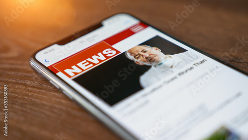 Close up of businessman reading news or articles in a mobile phone screen app Wallpaper Mural