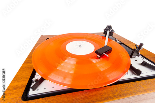 Vintage turntable with a red vinyl isolated on white Wallpaper Mural