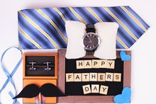 Father's Day Greeting Card Message With Mustache And Different Gifts On White Background.Flat Lay Composition With Phrase HAPPY FATHER'S DAY, Watch, Tie And Bijouterie Cuff Links.Father's Day Concept.