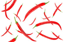 Falling Red Hot Chilli Peppers Isolated On A White Background With Clipping Path. Flying Vegetables. Top View.