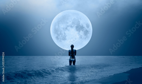 Night sky with moon in the clouds on the foreground power sea wave - Happy slim Canvas Print