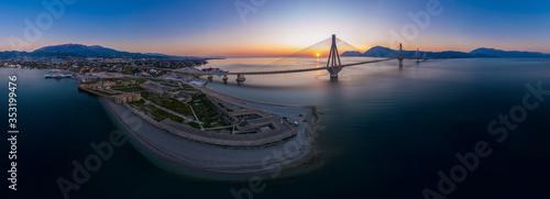 Obraz Wide panorama of world famous  Rio - Antirio Harilaos Trikoupis bridge at sunset time - fototapety do salonu