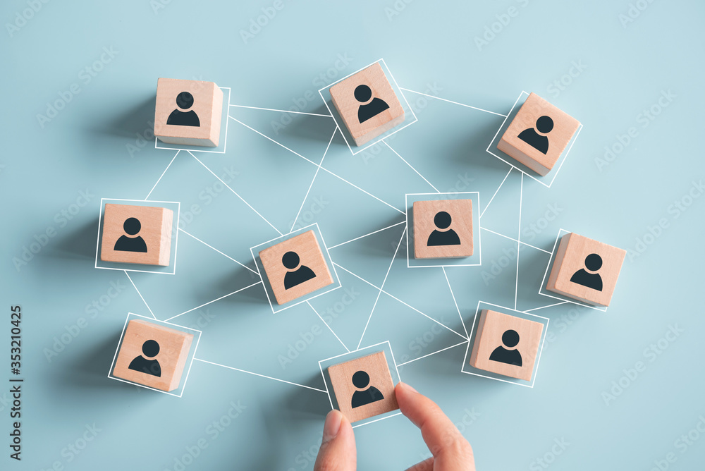 Fototapeta Building a strong team, Wooden blocks with people icon on blue background, Human resources and management concept.