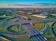 canvas print picture - A beautiful panoramic aerial drone view of the sunset on the highway overpass of the southern Warsaw bypass (Polish: POW), Michalowice district in Warsaw, Opacz Kolonia, Poland