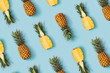 Leinwanddruck Bild Colorful pattern of pineapples on pastel blue background. Top view. Minimal tropical fruit summer concept.