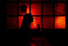 Silhouette Of A Female Holding...