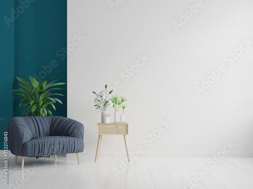 Obraz The interior has a armchair on empty white wall background. - fototapety do salonu
