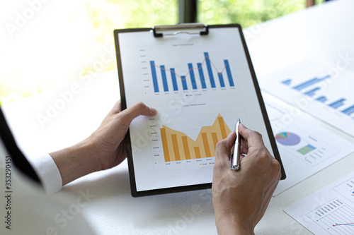 Fototapeta Head of marketing has analyzed the financial income graph of the company in order to develop the structure of the company to be ready for the economy in the future. Financial results analysis concept. obraz