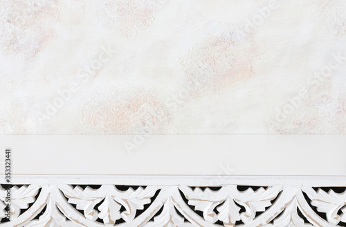 Fototapeta background Image of vintage table in front of white oriental decorative wall