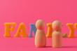Leinwandbild Motiv Wooden little figures of people. Family concept