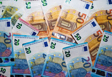 Backgound Of Lots Of Euro Notes Of Mixed Value. Background Of Different Euro Banknotes.