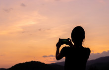 Silhouette Of Women Taking Pho...