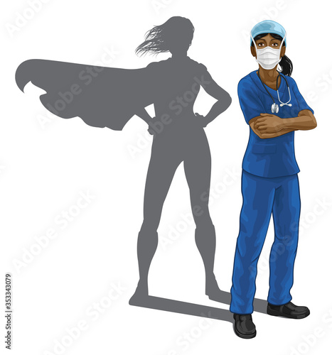 Obraz A nurse or doctor super hero woman in surgical or hospital scrubs with stethoscope and mask PPE. With arms folded and serious but caring look. Revealed as a superhero by the shape of her shadow. - fototapety do salonu