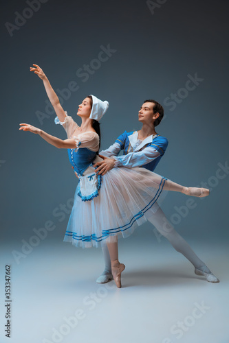 Young and graceful ballet dancers as Cindrella fairytail characters on studio background Wallpaper Mural