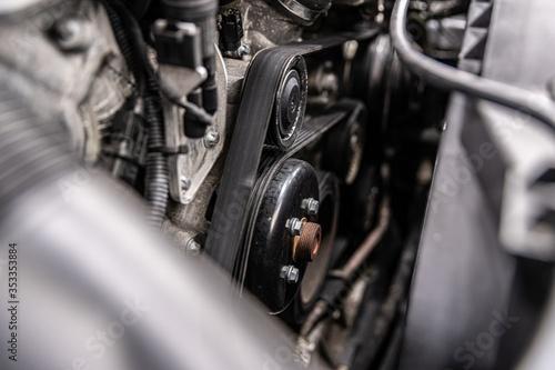 Obraz Fan belt and v-belt powering alternator, water pump and air conditioner compressor. - fototapety do salonu