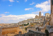 Panoramic view of the ancient town of Matera (Sassi di Matera), European Capital of Culture 2019,and UNESCO Heritage site with blue sky and clouds, Basilicata, southern Italy