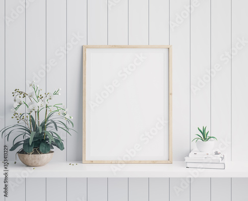 Mockup poster vertical frame close up in coastal style interior with flowers, books and minimal pot on white shelf. 3D render