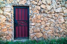 A Purple Metal Door With A Bla...