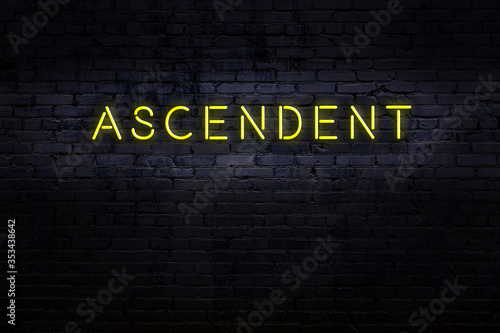 Night view of neon sign on brick wall with inscription ascendent Wallpaper Mural