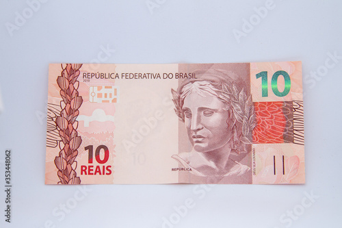 Photo ten reais banknote (Brazilian currency) on a white background