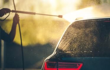 Modern Car Washing Using Pressure Washer in a Car Wash.