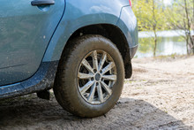 Dirty Car Wheel Closeup In A Countryside Road. Off Road Concept. 4x4