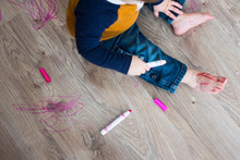 Little Boy Draws With Marker On Floor