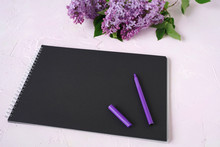 Bouquet Of Lilac Flowers And Purple Pen On A Blackboard