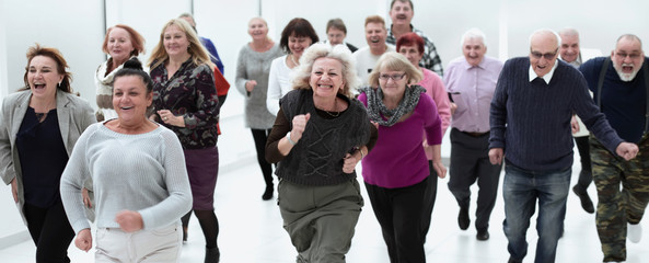 a group of retirees are running for retirement. group of older p