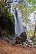 Beautiful Waterfall Among Rocks In Spring Time