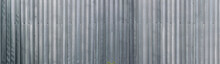 Panoramic View Of Profiled Sheet Metal Wall. Gray Metal Texture Surface. Seamless Background.