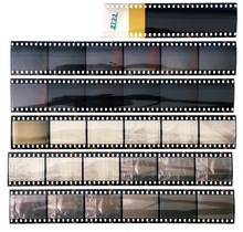 Set Of Real Long 35mm Positive Strips On White Background, Contact Sheet With Empty Frames Or Film Cells.