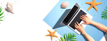 Person Using A Laptop Computer With Summer Theme Objects - Flat Lay