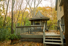 Gazebo Made Of Wood In My Backyard In The Middle Of A Forest With Leaves Everywhere
