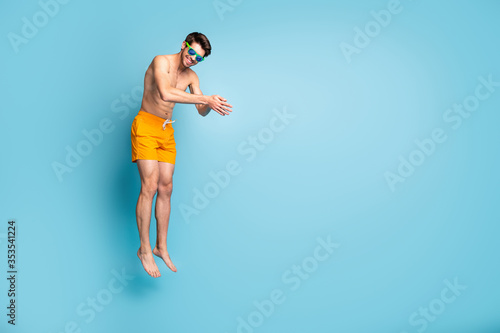 Full length body size view of his he nice attractive cheerful sportive guy in sw Fototapeta