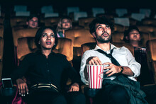 Audience Sitting In A Cinema A...
