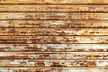 Rusted Storefront Rolling Shutter, Stripes Of Rusted Metal.