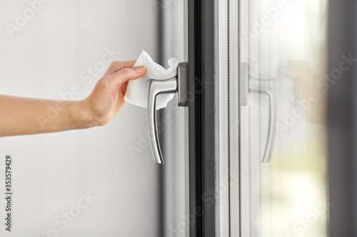 hygiene, health care and safety concept - close up of woman hand cleaning window Canvas