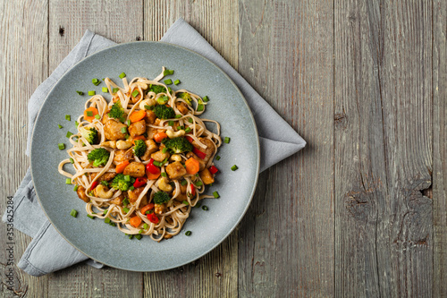 stir-fry pasta with chicken, broccoli and carrots. Wallpaper Mural
