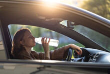 Woman Drinks Water From A Refi...