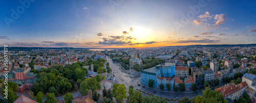 Leinwand Poster Aerial view from the drone of the magnificent sunset over centrum of Varna city,