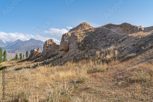 The view of old ancient ruined city Koshoy Korgon and the clay city wall in Kyrg Fototapeta