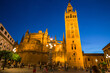 Night view of the Plaza Virgen de los Reyes with the Giralda and the cathedral of Seville, Spain.