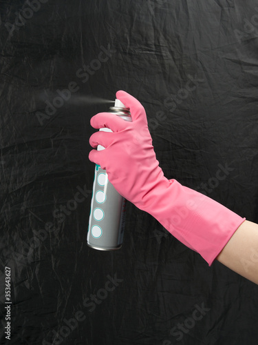 female hand in a rubber glove with an aerosol can Canvas Print