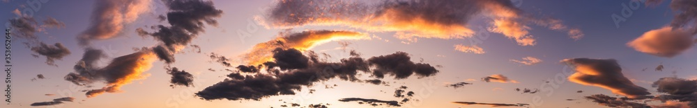 Fototapeta Sunset dramatic sky background and colorful dark clouds.
