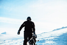 A Person Wearing A Black Ski S...
