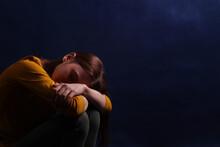 Teen Girl Sitting Hugging His ...