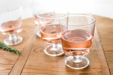 Glasses Of Rose Wine On Wooden...